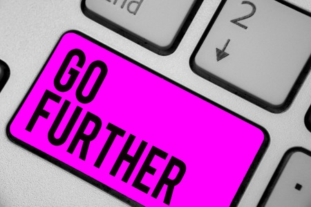 Text sign showing Go Further. Conceptual photo To move to a greater distance or overcome your limitations Keyboard purple key Intention create computer computing reflection document