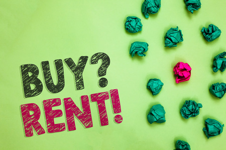 Text sign showing Buy question Rent. Conceptual photo Group that gives information about renting houses Crumpled wrinkled papers one different pink unique special green background