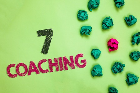 Text sign showing 7 Coaching. Conceptual photo Refers to a number of figures regarding business to be succesful Crumpled wrinkled papers one different pink unique special green background Stock Photo