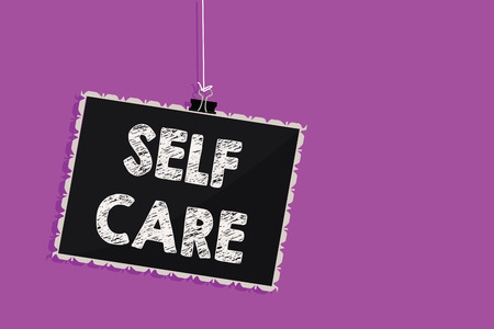 Text sign showing Self Care. Conceptual photo Give comfort to your own body without professional consultant Hanging blackboard message communication information sign purple background