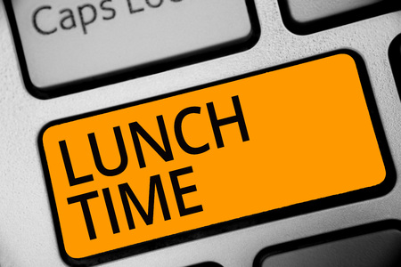 Conceptual hand writing showing Lunch Time. Business photo showcasing Meal in the middle of the day after breakfast and before dinner Keyboard orange key computer computing reflection document Imagens