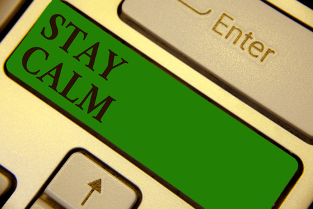 Conceptual hand writing showing Stay Calm. Business photo text Maintain in a state of motion smoothly even under pressure Keyboard green key create computer computing reflection document Stock Photo