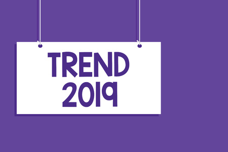 Conceptual hand writing showing Trend 2019. Business photo showcasing things that is famous for short period of time in current year Hanging board message open close sign purple background