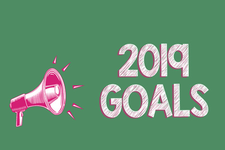 Handwriting text writing 2019 Goals. Concept meaning A plan to do for something new and better for the coming year Megaphone loudspeaker green background important message speaking loud Banco de Imagens