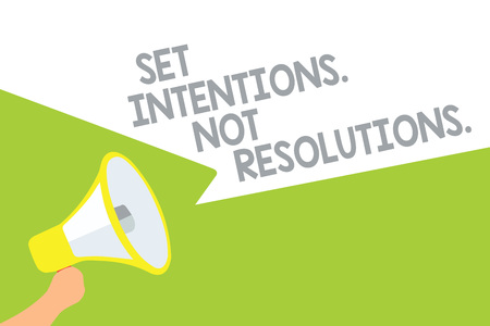 Text sign showing Set Intentions. Not Resolutions.. Conceptual photo Positive choices for new start achieve goals Megaphone loudspeaker speech bubbles important message speaking out loud