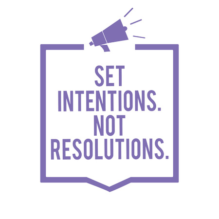 Handwriting text writing Set Intentions. Not Resolutions.. Concept meaning Positive choices for new start achieve goals Megaphone loudspeaker purple frame communicating important information 版權商用圖片