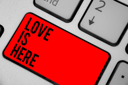 Conceptual hand writing showing Love Is Here. Business photo text Romantic feeling Lovely emotion Positive Expression Care Joy Keyboard red key create computer computing reflection document