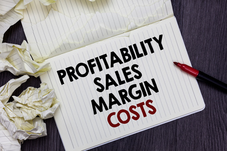 Writing note showing Profitability Sales Margin Costs. Business photo showcasing Business incomes revenues Budget earnings Marker over notebook crumpled papers pages several tries mistakes Stock Photo