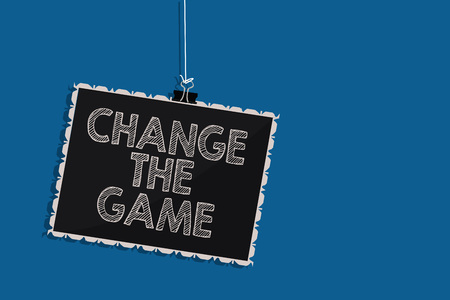 Writing note showing Change The Game. Business photo showcasing Make a movement do something different new strategies Hanging blackboard message communication information blue background