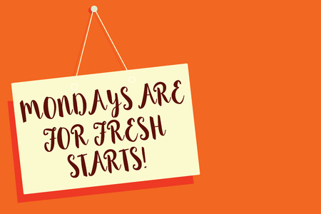 Conceptual hand writing showing Mondays Are For Fresh Starts. Business photo showcasing Begin again every week have a good morning Beige board communication open close sign orange background Stock Photo