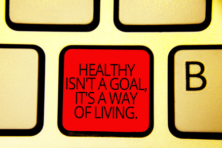 Text sign showing Healthy Isn t not A Goal, It s is A Way Of Living.. Conceptual photo Create good habits routines Keyboard red key Intention create computer computing reflection document