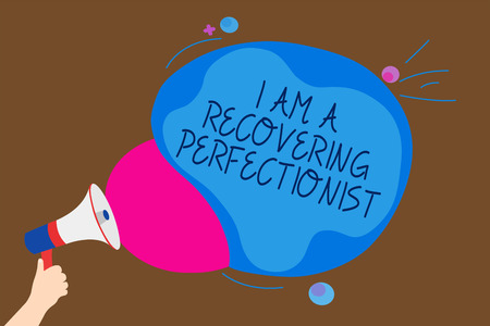 Conceptual hand writing showing I Am A Recovering Perfectionist. Business photo text Obsessive compulsive disorder recovery Man holding Megaphone loudspeaker screaming talk speech bubble
