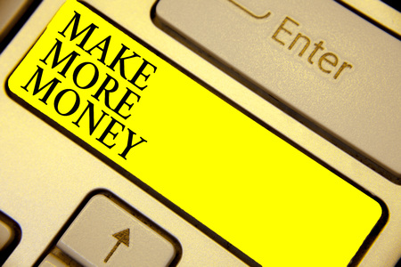 Writing note showing Make More Money. Business photo showcasing Increase your incomes salary benefits Work harder Ambition Keyboard yellow key Intention computer computing reflection document 写真素材