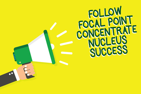 Writing note showing Follow Focal Point Concentrate Nucleus Success. Business photo showcasing Concentration look for target Man holding megaphone loudspeaker yelliw background speaking loud Stock Photo