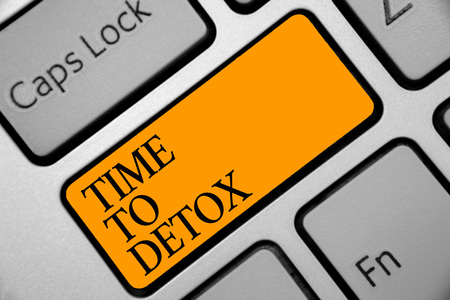 Conceptual hand writing showing Time To Detox. Business photo showcasing Moment for Diet Nutrition health Addiction treatment cleanse Keyboard orange key computer computing reflection document Foto de archivo