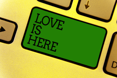 Conceptual hand writing showing Love Is Here. Business photo text Romantic feeling Lovely emotion Positive Expression Care Joy Keyboard green create computer computing reflection document