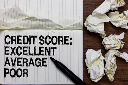 Handwriting text writing Credit Score Excellent Average Poor. Concept meaning Level of creditworthness Rating Report Marker over notebook crumpled papers ripped pages several tries mistakes