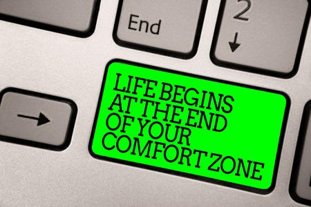 Conceptual hand writing showing Life Begins At The End Of Your Comfort Zone. Business photo showcasing Make changes evolve grow Keyboard green key computer computing reflection document Reklamní fotografie