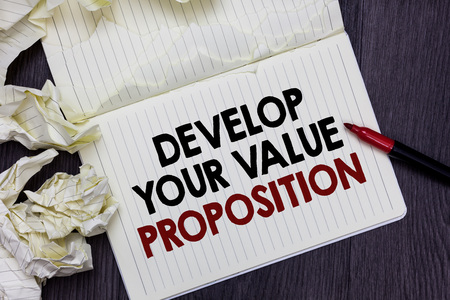 Writing note showing Develop Your Value Proposition. Business photo showcasing Prepare marketing strategy sales pitch Marker over notebook crumpled papers pages several tries mistakes Stock Photo
