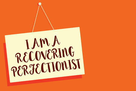 Conceptual hand writing showing I Am A Recovering Perfectionist. Business photo showcasing Obsessive compulsive disorder recovery Beige board communication open close sign orange background Imagens