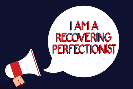 Writing note showing I Am A Recovering Perfectionist. Business photo showcasing Obsessive compulsive disorder recovery Man holding megaphone loudspeaker speech bubble black background Stock Photo