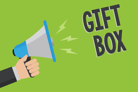 Writing note showing Gift Box. Business photo showcasing A small cointainer with designs capable of handling presents Man holding megaphone loudspeaker green background message speaking