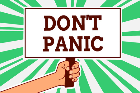 Writing note showing Don t not Panic. Business photo showcasing sudden strong feeling of fear prevents reasonable thought Man hand holding poster important protest message green ray background Stock Photo