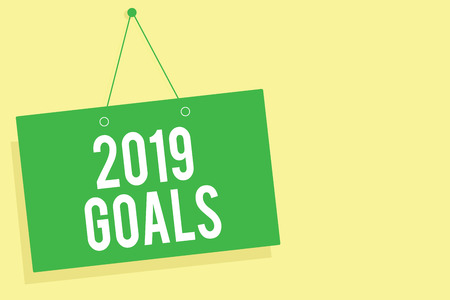 Word writing text 2019 Goals. Business concept for A plan to do for something new and better for the coming year Green board wall message communication open close sign yellow background