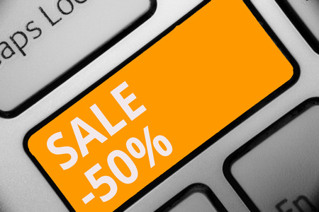 Writing note showing Sale 50. Business photo showcasing A promo price of an item at 50 percent markdown Keyboard orange key Intention computer computing reflection document