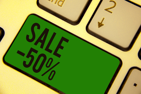 Writing note showing Sale 50. Business photo showcasing A promo price of an item at 50 percent markdown Keyboard green key Intention computer computing reflection document