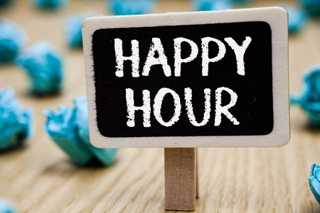 Text sign showing Happy Hour. Conceptual photo Spending time for activities that makes you relax for a while Blackboard crumpled papers several tries mistake not satisfied wooden floor