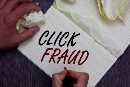 Word writing text Click Fraud. Business concept for practice of repeatedly clicking on advertisement hosted website Man holding marker notebook crumpled papers ripped pages mistakes made