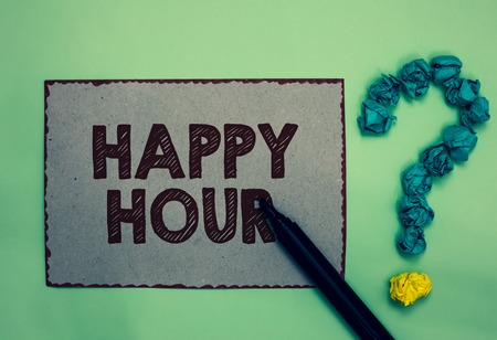 Word writing text Happy Hour. Business concept for Spending time for activities that makes you relax for a while Gray paper marker crumpled papers forming question mark green background