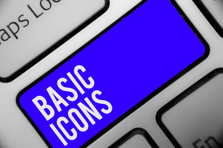Writing note showing Basic Icons. Business photo showcasing pictogram or ideogram displayed on a computer screen or phone Keyboard blue key Intention computer computing reflection document
