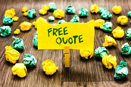 Writing note showing Free Quote. Business photo showcasing A brief phrase that is usualy has impotant message to convey Clothespin holding yellow note paper crumpled papers several tries