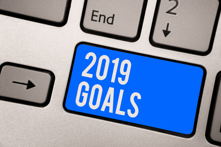 Text sign showing 2019 Goals. Conceptual photo A plan to do for something new and better for the coming year Keyboard blue key Intention create computer computing reflection document