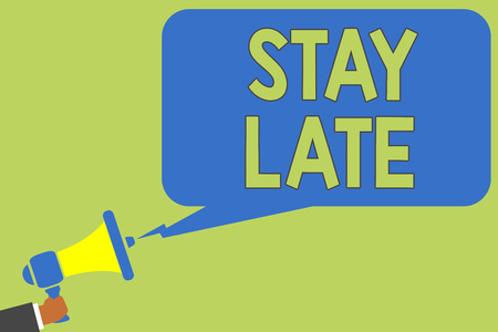 Text sign showing Stay Late. Conceptual photo A routine in which a person goes to somewhere out of time Man holding megaphone loudspeaker speech bubble message speaking loud Stock Photo
