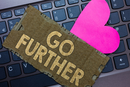 Conceptual hand writing showing Go Further. Business photo text To move to a greater distance or overcome your limitations Paperboard Romantic lovely message Heart Keyboard Type computer Stock fotó