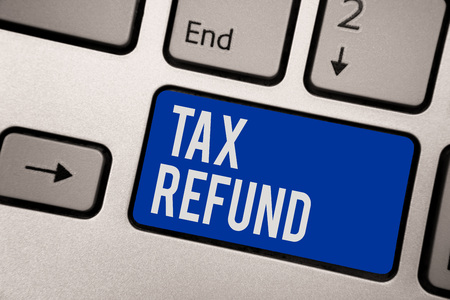 Writing note showing Tax Refund. Business photo showcasing applied when money liability is less than the paid ones Keyboard blue key Intention computer computing reflection document Stock fotó