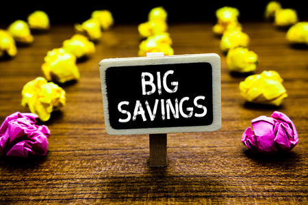 Text sign showing Big Savings. Conceptual photo income not spent or deferred consumption putting money aside Blackboard crumpled papers several tries mistake not satisfied wooden floor Banque d'images