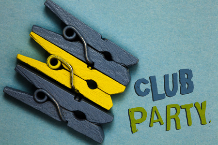 Conceptual hand writing showing Club Party. Business photo text social gathering in a place that is informal and can have drinks Gray yellow vintage clothespins clear background Holding things Stock Photo