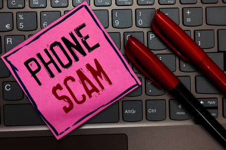Writing note showing Phone Scam. Business photo showcasing getting unwanted calls to promote products or service Telesales Pink paper keyboard Inspiration communicate ideas messages Red markers