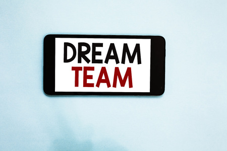 Text sign showing Dream Team. Conceptual photo Prefered unit or group that make the best out of a person Cell phone white screen over light blue background text messages apps Stock Photo