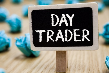Text sign showing Day Trader. Conceptual photo A person that buy and sell financial instrument within the day Blackboard crumpled papers several tries mistake not satisfied wooden floor Stock Photo