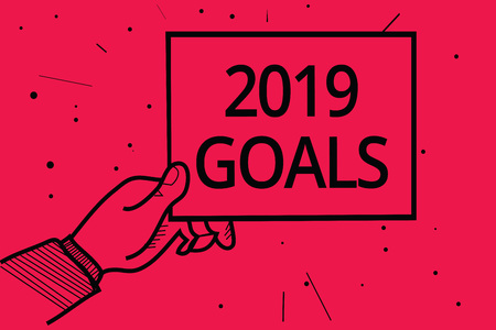 Conceptual hand writing showing 2019 Goals. Business photo text A plan to do for something new and better for the coming year Man holding paper communicating information dotted red background