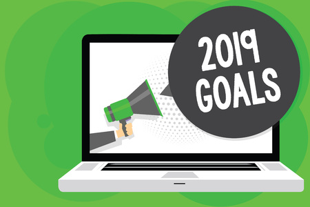 Conceptual hand writing showing 2019 Goals. Business photo text A plan to do for something new and better for the coming year Man holding Megaphone loudspeaker computer screen speech bubble Banco de Imagens