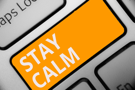 Writing note showing Stay Calm. Business photo showcasing Maintain in a state of motion smoothly even under pressure Keyboard orange key Intention computer computing reflection document Фото со стока