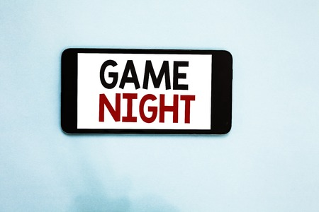 Text sign showing Game Night. Conceptual photo event in which folks get together for the purpose of getting laid Cell phone white screen over light blue background text messages apps