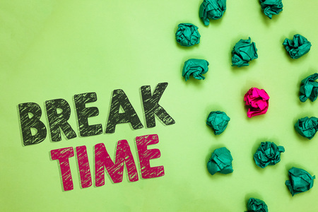 Text sign showing Break Time. Conceptual photo Period of rest or recreation after doing of certain work Crumpled wrinkled papers one different pink unique special green background Stock Photo