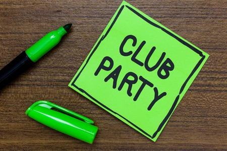 Conceptual hand writing showing Club Party. Business photo showcasing social gathering in a place that is informal and can have drinks Green Paper Communicate ideas Marker Wooden background